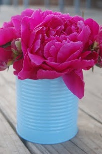 Tin can painted and used as vase for flowers. Great idea for center pieces.
