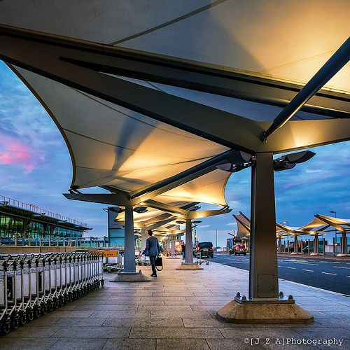 Pascall Watson's tensile roofs provide a dramatic & sculptural entrance to Rogers' Heathrow T5