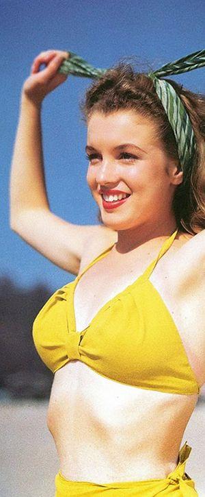 1945: Marilyn Monroe – Norma Jeane – at the beach in a yellow bikini