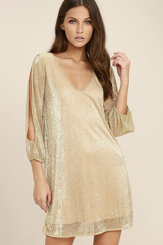 Lulus Exclusive! The I'm Glistening Gold Long Sleeve Shift Dress has just the right amount of glitz to get their attention! Beige knit, with metallic gold threading, sparkles over a roomy shift silhouette with a V-neckline and sheer, long sleeves with trendy, cold shoulder cutouts.