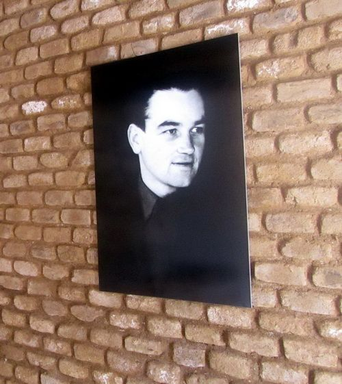 Portrait of Jan Kubiš in the lobby of his home.