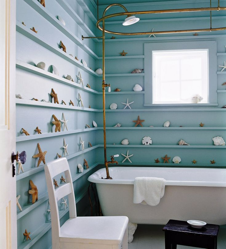 Absolutely adorable beach bathroom. Love the idea of lining the walls with starfish, shells and sand dollars and the antique claw foot tub.