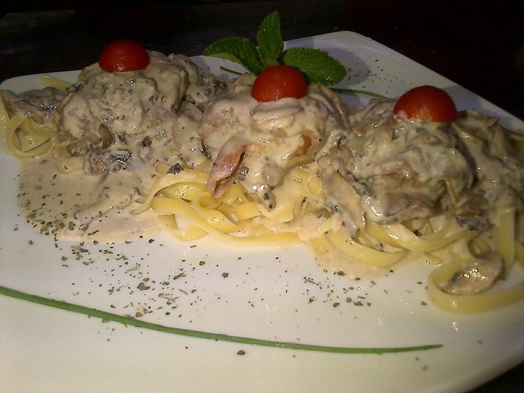 Tender beef fillet stuffed with parma ham , mozzerella , and peppa dews pan seared and smothered in a creamy mushroom sauce on a bed of fettuchinni pasta