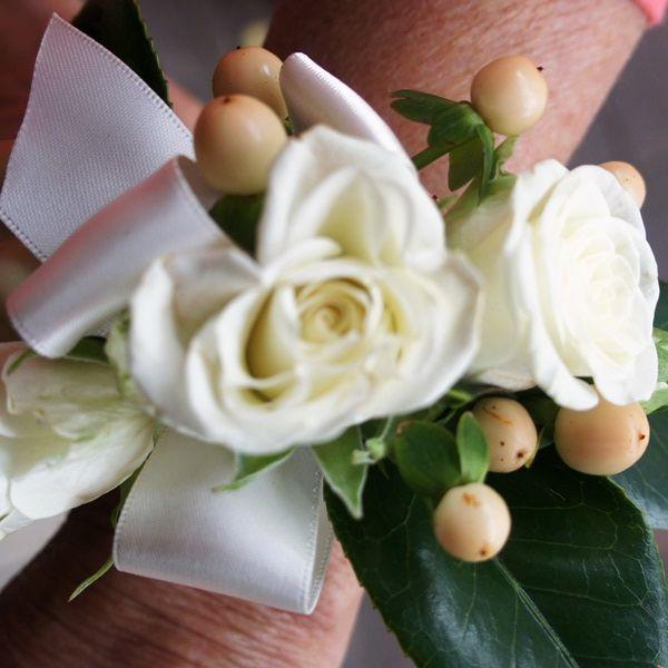 Wrist corsage. For more wedding flower designs go to www.naomijones.com.au.