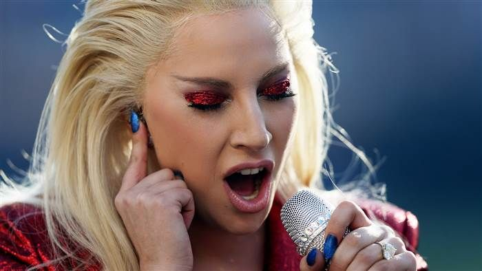 Super Bowl 50: Lady Gaga's National Anthem brings glittery start to game