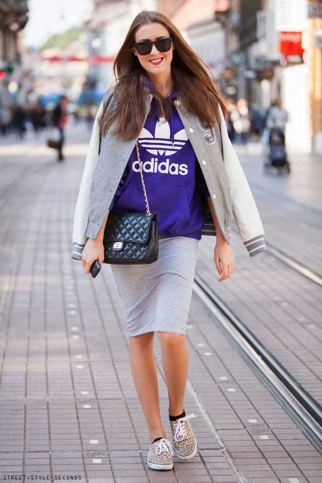 Trendy varsity jacket worn with leopard Vans sneakers and quilted bag. Street style women's latest fashion
