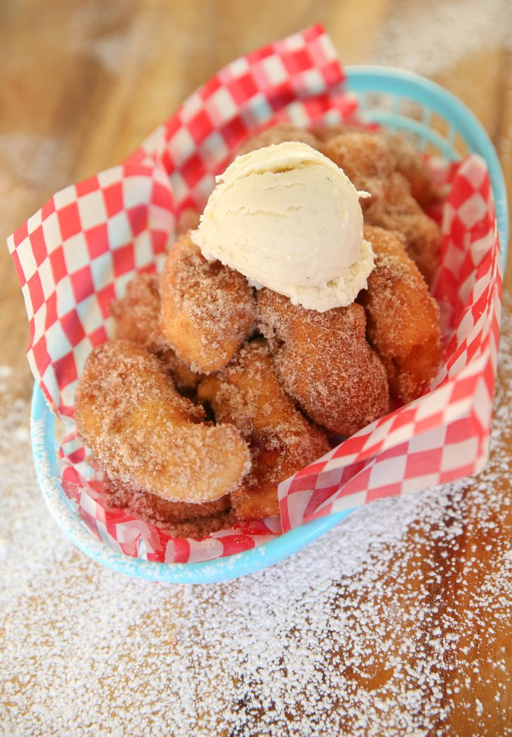 Deep Fried Peaches - Fresh ripe peaches, dipped in funnel cake batter, fried, rolled in cinnamon-sugar and topped with ice cream or whipped cream. Enough said!