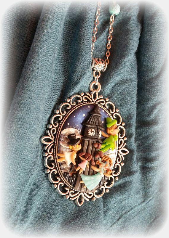 Polymer clay, necklace with cameo with Peter Pan. Follow me on Facebook : www.facebook.com/BijouxdiPatty