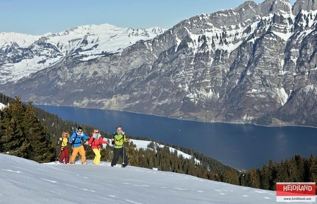 Snowshoing on the Flumserberg Mountains with the Lake Walen (Walensee) in the background.