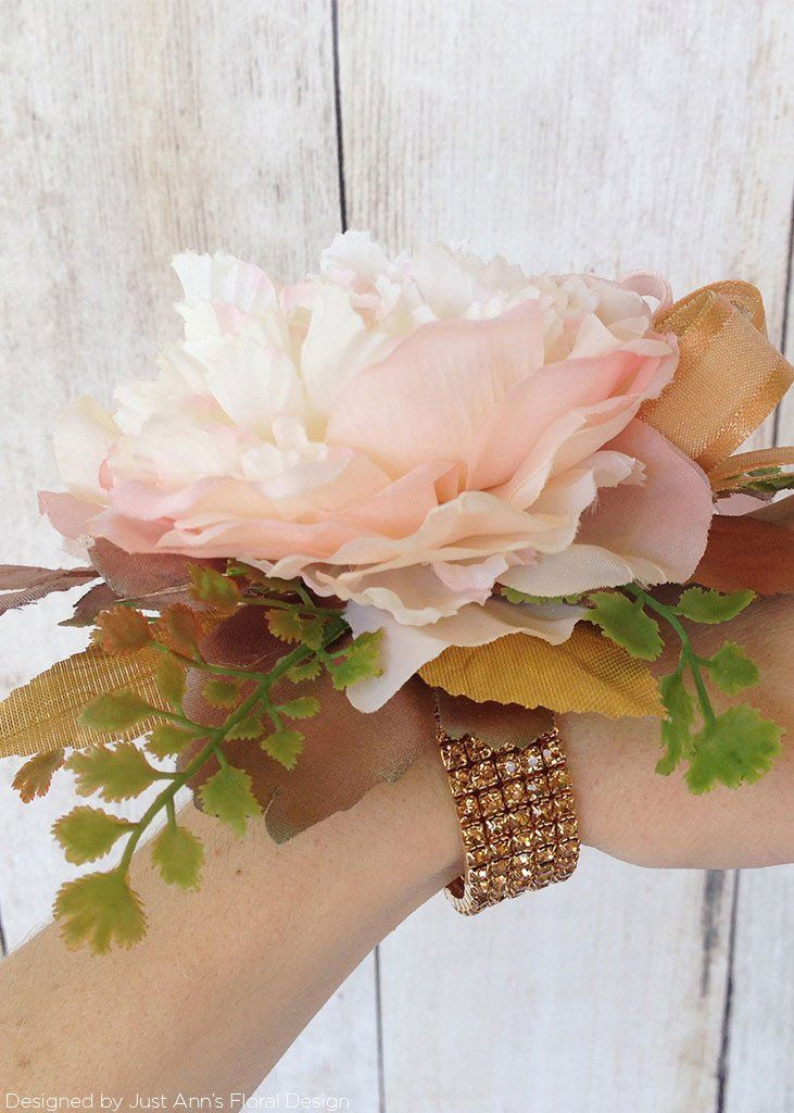 Add sparkle and shine to your faux flowers and leaves with this Rose Gold Spray Paint available at Afloral.com