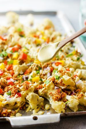 """These Vegan Cauliflower Nachos with Walnut Taco """"Meat"""" are perfect if you are looking for a snack that is packed with flavor AND nutrition."""