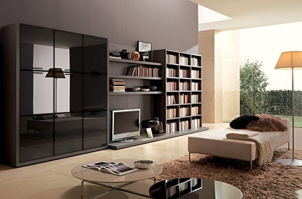 Simple living room interior design ideas with black wall using bookshelves complete yv using cabinet of lid also windows and free standing lighting for night that have beige leather sofa iron frame and double white black countertops round table designs also beige ceramic flooring fabric idea