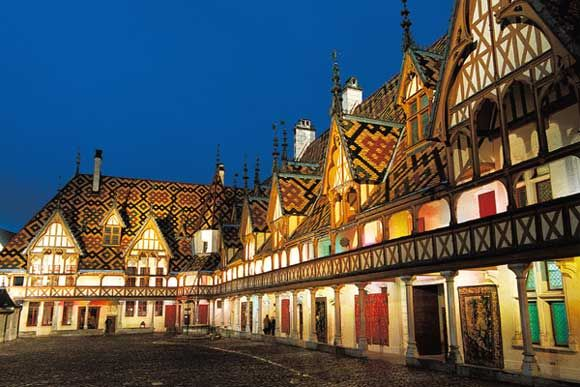 Les Hospices de Beaune.... Look at those roof tiles. They last 300 years, and are fired three times; once for clay, once for color, once for glaze.