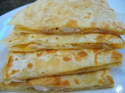Chicken and Cheese Quesadillas -- To a skillet on med-high heat, melt a little BUTTER. Place a TORTILLA over the butter and sprinkle it with shredded CHEESE and some cooked (chopped) CHICKEN. Top with another TORTILLA, then pan grill on each side until golden brown and heated through.  Cut into slices and serve with salsa, sour cream, guacamole, etc.   Rotisserie chicken works great in these.