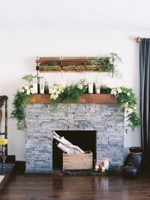 Vine, fern, and poinsettia fireplace garland by Sarah Winward.