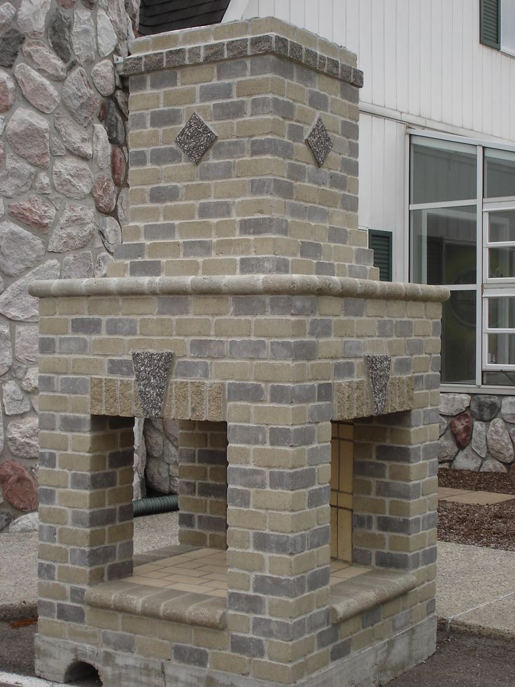Sided Brick And Mortar Outdoor Fireplace With Mantel And