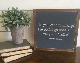 Change the world quote sign