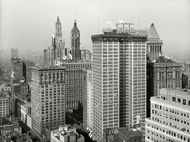 """New York circa 1917. """"Skyscrapers, looking north toward towers of Woolworth and Singer buildings."""" Double-barreled tower in the foreground is the Adams Express Building."""