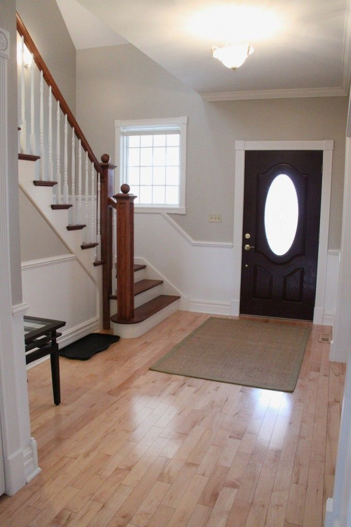 I like how wide this entry is and that the stairs aren't directly in front of the door. Accessible Beige by Sherwin Williams