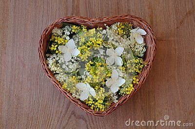 Heart-shaped basket with colorful spring flowers