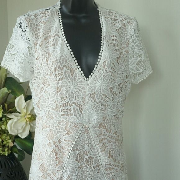 Lace Romper Adorable lace romper with deep v front and open back. Scalloped edges with pearl like detail. Beautiful cut through the front that softens the overall look. Nude body with creamy lace overlay adds a vintage feel. Gorgeous piece that can be worn casual with sandals and a wide brimmed hat or dressed up with great heels and a fun clutch. Brand new without tags Dresses