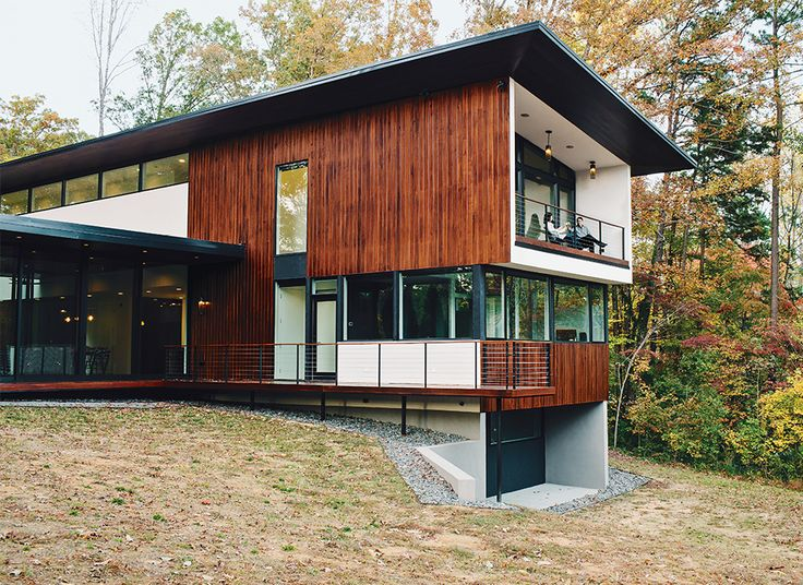 Charming Floors Are Sealed And Waxed Concrete. The 4,200 Square Foot Home Is Clad