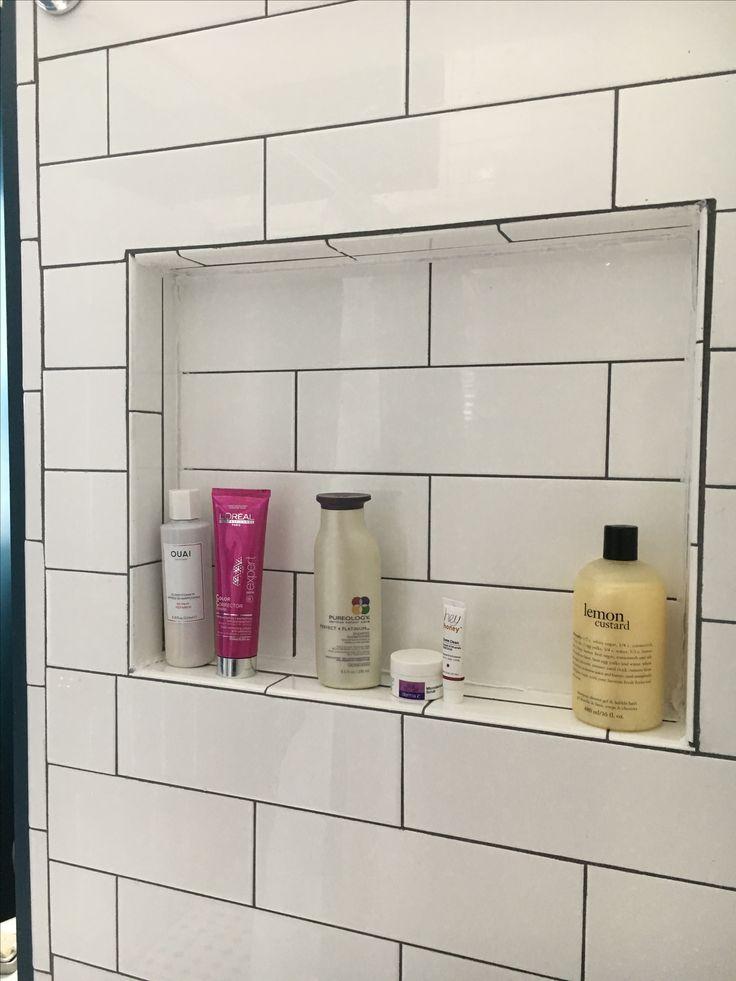 Shower niche, recessed shower shelf, white subway tile.