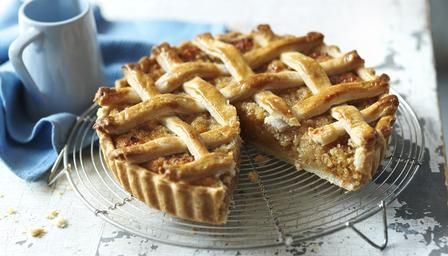 Mary Berry's treacle tart with woven lattice top. The filling is made of breadcrumbs, lemon zest and golden syrup - mmm!