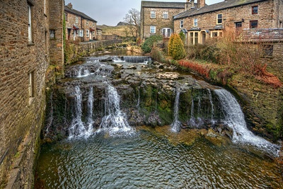 CASCADING CREEK  Hawes, England.  I think I've extolled the virtues of Hawes before, a little village in the beautiful Yorkshire Dales region of England, but here I go again.  This image shows the small creek running between houses and shops and cascading down a small waterfall.  Picture postcard material, what do you think!