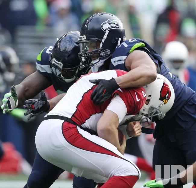 Seattle Seahawks defensive end Michael Bennett (72) and outside linebacker K.J. Wright (50) sack Arizona Cardinals quarterback Carson…