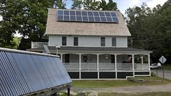 """Solar Thermal Energy Storage - by storing summer heat provides winter warmth.  """"The tank is heated all summer with the solar collector and heat is retrieved in the winter. A ventilator brings in fresh air, warms it and recirculates it.  The owner has been through one winter with most heat provided by the storage system. They did us about $600 of electrical backup."""