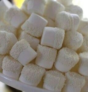 Marshmallows dipped in white chocolate with white nonpariels or coconut. Great for Christmas party platters and bridal shower favors