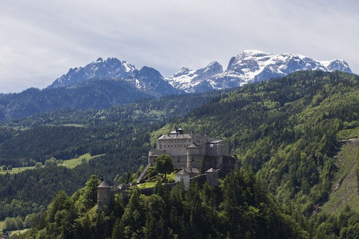 """With the Austrian Alps as a backdrop, Hohenwerfen Castle stands out in the forest of green trees surrounding this impressive white structure. Located in Werfen, 40 km (25 miles) south of Salzburg, the castle dates back to the 11th century when it was built to protect the Archbishopric of Salzburg from invaders. The castle also has served as a residence, hunting lodge, prison and police academy. It is looks familiar, it was featured in The Sound of Music when the children sing """"Do Re Mi."""""""
