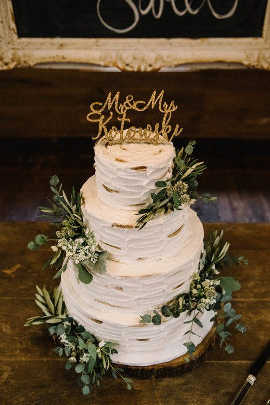 Rustic wedding cake -buttercream frosting, greenery and gold cake topper {Rivet Events}