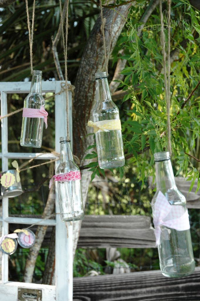 empty bottles dangling from tree branches... #bottle