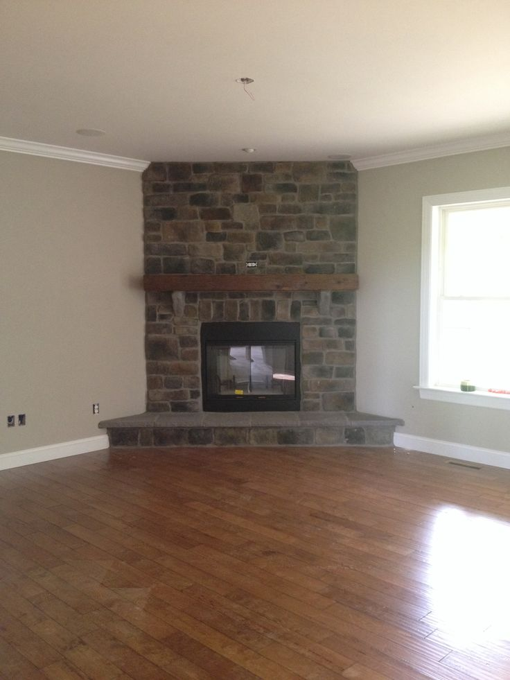 Our finished great room fireplace - cobblestone, barn beam ...