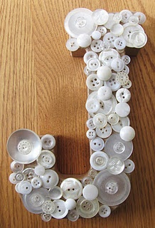 Button Letters.  I think they have big letters at Hobby Lobby that you could use to glue the buttons onto.