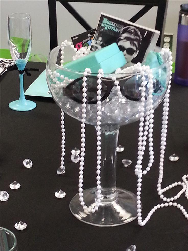 DIY Breakfast at Tiffany's centerpiece. Large glass, add pearls, Tiffany boxes, faux diamonds & black sunglasses.