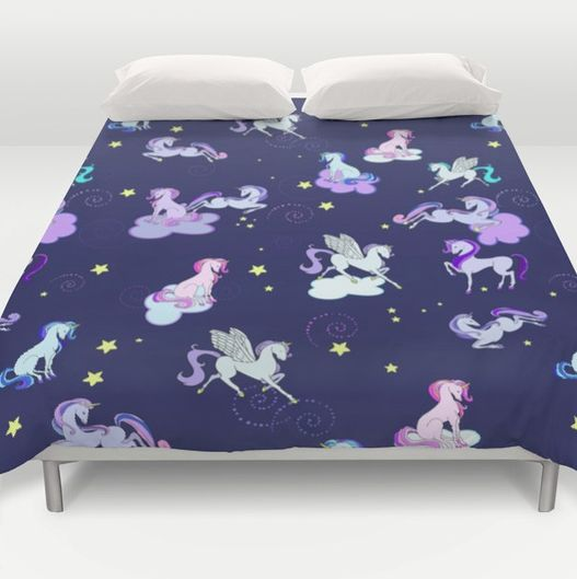 Cute little girls unicorn and stars blanket.https://society6.com/product/midnight-unicorns_duvet-cover?#s6-6916385p38a46v382