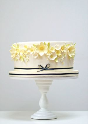 yellow-and-black-celebration-cake -- love this! but make the flowers raspberry