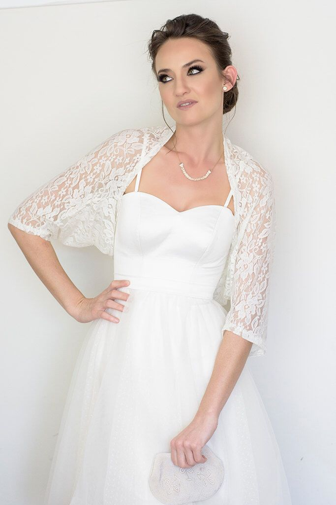A personal favorite from my Etsy shop https://www.etsy.com/il-en/listing/195524934/bridal-cover-up-white-lace-cover-up