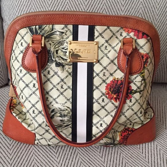 L.A.M.B Purse Marigold Gwen Stefani L.A.M.B. Used purse. I received many compliments wearing this purse. Still in great condition, some wear near the bottom. It shows in the picture. If you need more pictures I can add some. L.A.M.B. Bags Totes