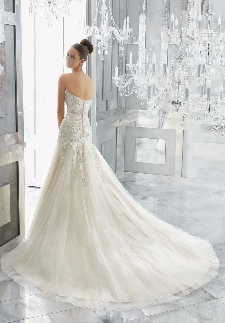 A Classically Elegant Fit and Flare Wedding Gown Comes to Life with Crystal Beaded Alençon Lace Appliqués and Gored Tulle Skirt. A Removable Beaded Organza Belt, Also Sold Separately as Style 11265, Completes the Look. Colors Available: White/Silver, Ivory/Silver,Ivory/Light Gold Silver.