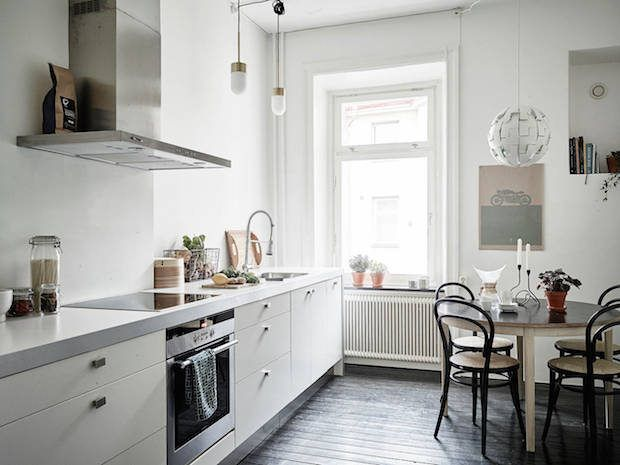 A calm Swedish home in neutrals (and a fab fireplace). Stadshem.