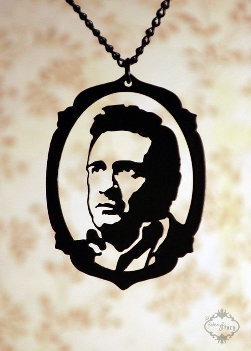 Johnny Cash tribute silhouette portrait necklace by FableAndFury. $26.00, via Etsy.