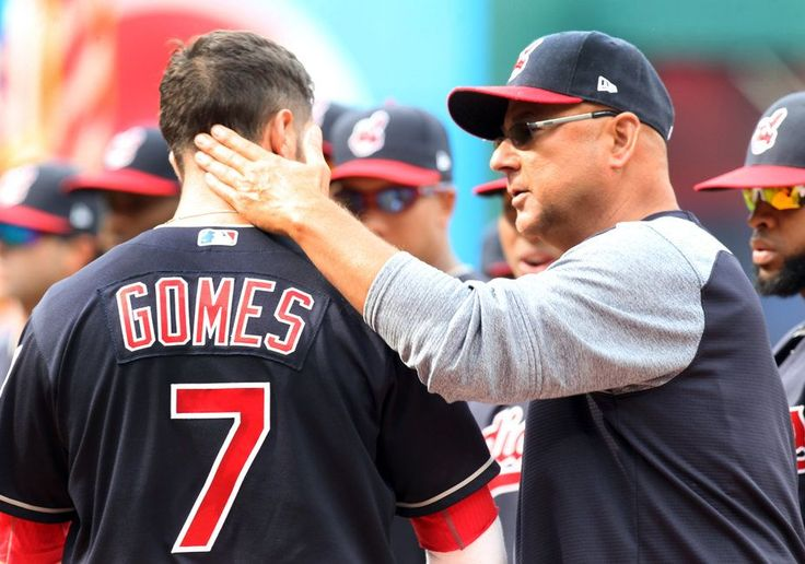 Indians coach Terry Francona talks with Yan Gomes before the Cleveland Indians home opener against the Chicago White Sox. (Chuck Crow/The Plain Dealer)