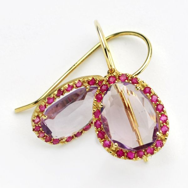 Gorgeous 14k gold earrings, hung with an oval shaped pink amethyst, surrounded by dark red rubies. Check it out at: http://grasjewellery.com/index.php/component/virtuemart/collection/282009-detail?Itemid=0