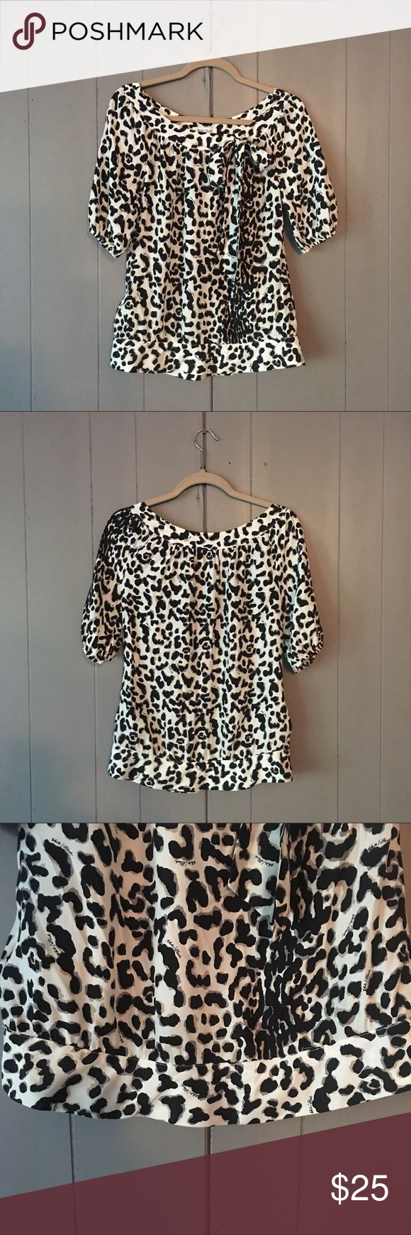 """✨Sale✨White House Black Market Animal print top✨ This top is so cute and in like new condition! 100% Silk. Bust is 34 (armpit to armpit is 17""""). Length is 25"""". White House Black Market Tops"""