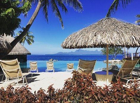 Just relax and enjoy the view !  : @rmsandrine  tahiti.intercontinental.com  #ICTahiti #frenchpolynesia #tahiti #resort #lagoon #pool #poolday #blue #sun #fun #travel #luxury #luxurytravels #honeymoon #honeymooners #relax #relaxing #view #moorea #palmtree #island #beautiful