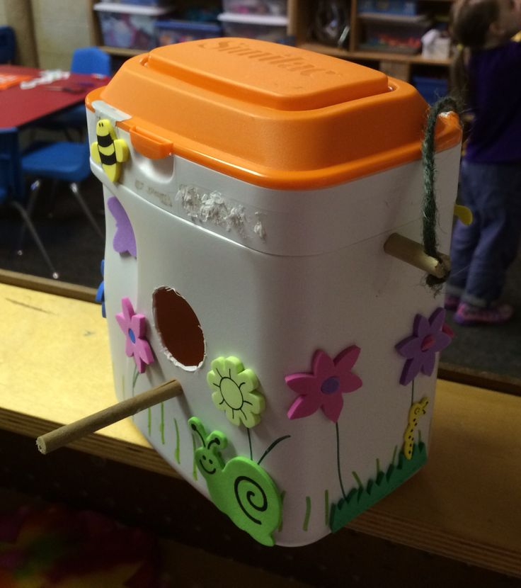 Great Earth Day project! Birdhouse made by recycling an infant formula container. Drilled holes and put stick through, then added twine for hanging. Drilled large hole and added perch. Preschoolers decorated it by adding foam flower stickers to pre-drawn stems! Up-cycled!! Created by my dear friend Dene Harris.